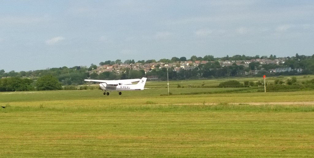 Another Club Plane lands